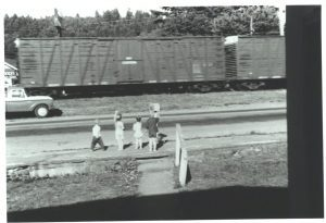 Kevin Horn, Gwyyn Finney, Pammy McLoughlin, and Kurt Horn wave to a passing train, 1967. Photo by Monita Horn.