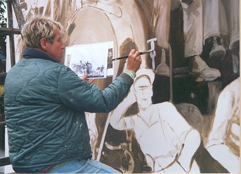 Larry Kangas, at work on the logging mural