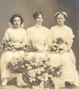 Issaquah High School graduates, 1911. Left to right: Mary Gibson, Olive Gibson, and Mabel Ek.
